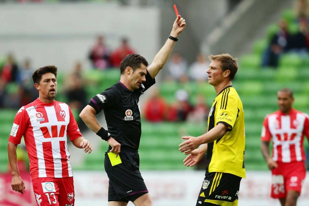 Ben Sigmund is shown a red card by referee Ben Williams against the Melbourne Heart after his second bookable offence.