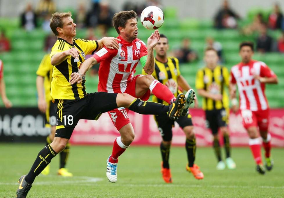 Ben Sigmund challenges Harry Kewell for the ball, which lead to his second yellow card.