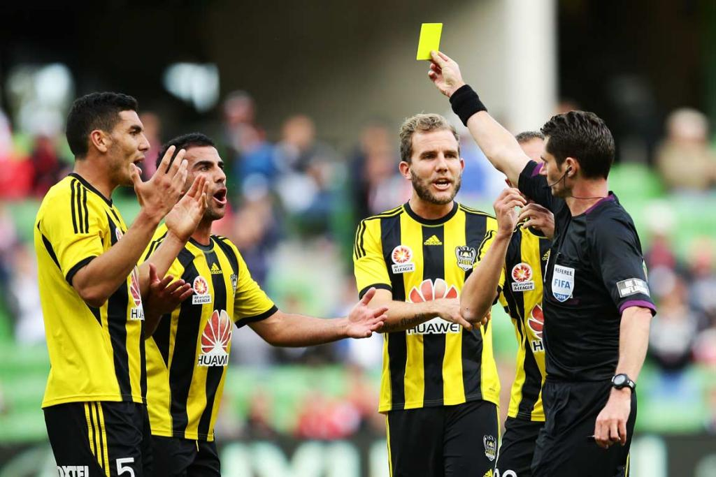 Phoenix players appeal for leniency as referee Ben Williams flashes another yellow card.