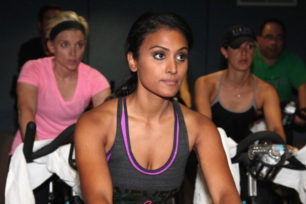 Miss America hosts a charity bike ride at a gym.