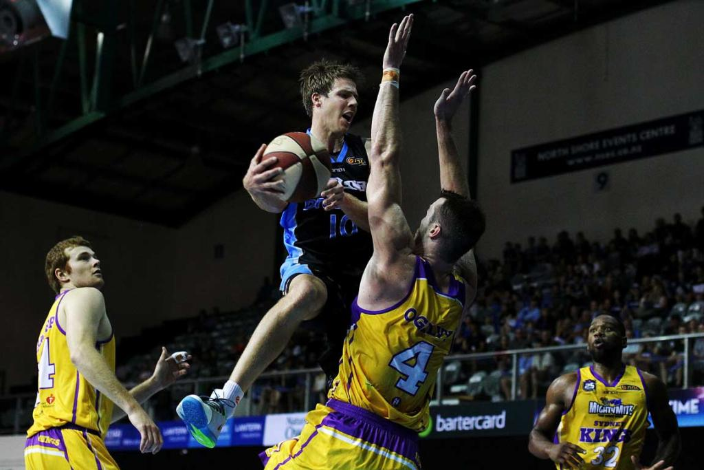 Tom Abercrombie jumps around the Sydney Kings' AJ Ogilvy and looks to pass.