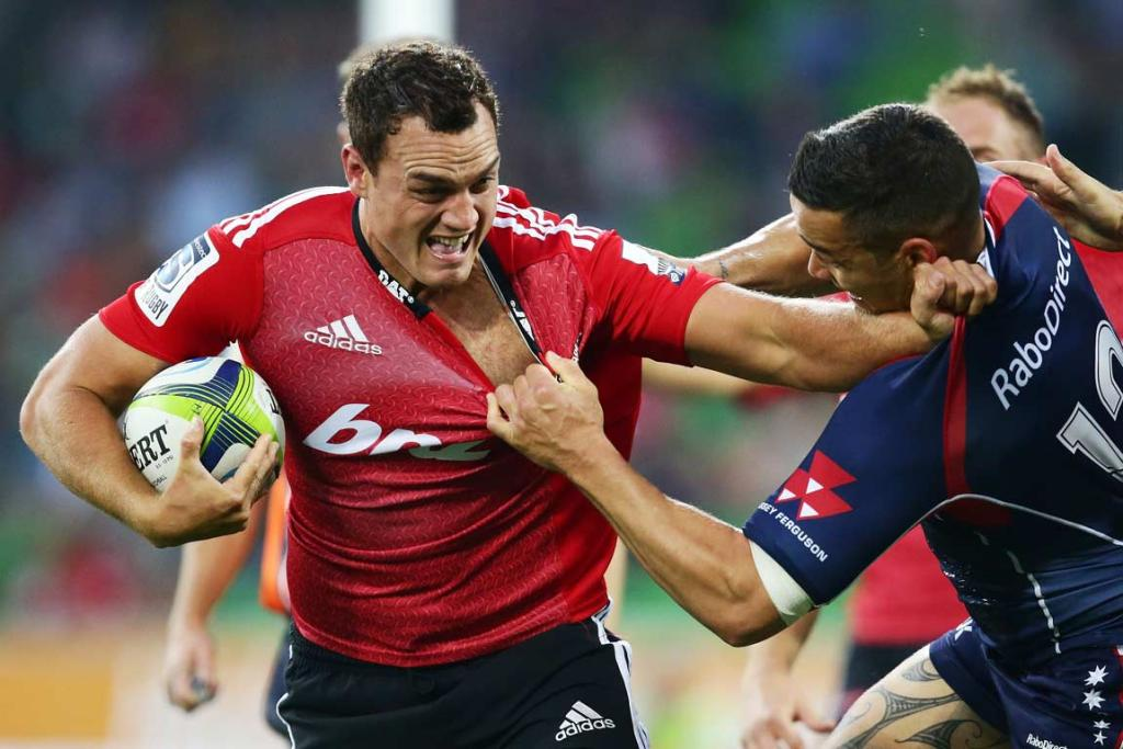 Israel Dagg attempts to get himself out of the grasp of a Melbourne Rebel.