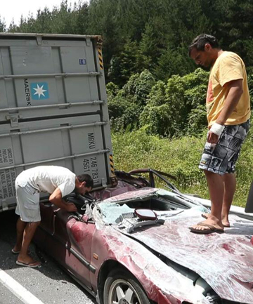 LUCKY TO BE ALIVE: Argentinian brothers Agustin Carrasco, left, and Matias Carrasco survey the wreckage of their crushed vehicle after an accident in Rai Valley last year.