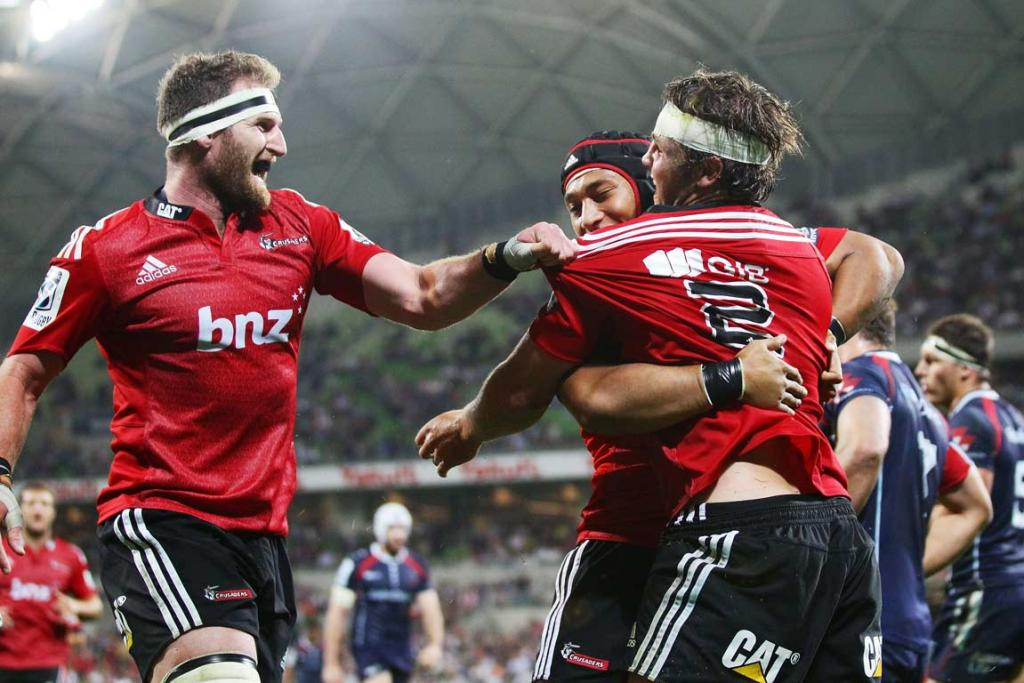 Crusaders Kieran Read (left) and Nafi Tuitavake rush to congratulate hooker Ben Funnell after scoring.