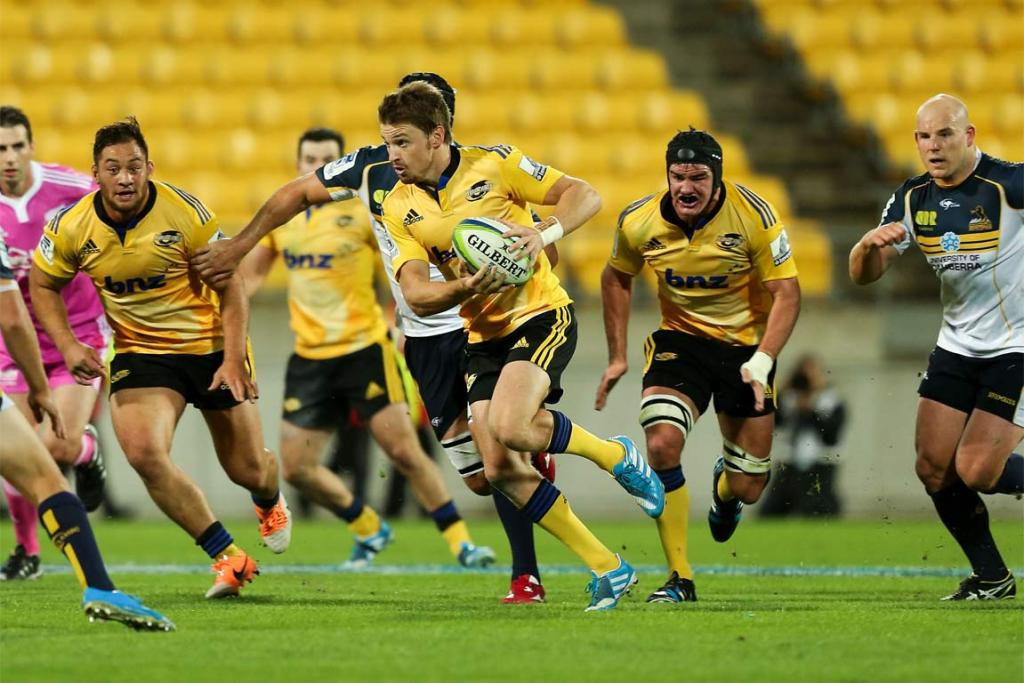 Beauden Barrett makes a break for the Hurricanes against the Brumbies in Wellington.