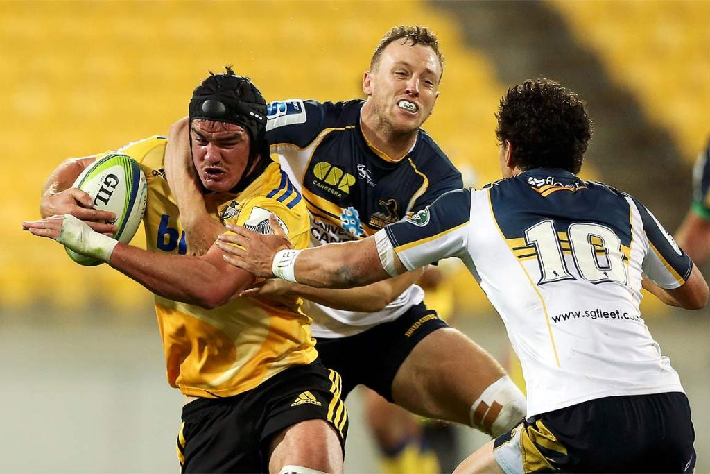 Adam Hill of the Hurricanes is tackled by Jesse Mogg of the Brumbies in Wellington.