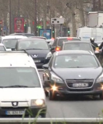 BANNED: Cars with even-numbered plates were kept off the road on Monday in Paris, in an effort to reduce pollution.