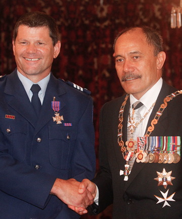 BRAVERY REWARDED: Nelson police officer Michael Wardle receives his New Zealand Bravery Medal from Governor-General Sir Jerry Mateparae.