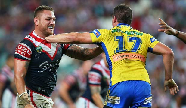 SQUARING UP: Jared Waerea-Hargeaves and Darcy Lussick tussle during their round two NRL match.