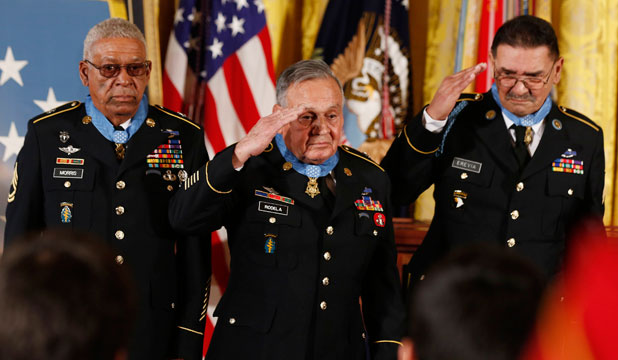VALOUR:Army Staff Sergeant Melvin Morris, Army Sergeant First Class Jose Rodela and Army Specialist Four Santiago Erevia each receive a Medal of Honor.