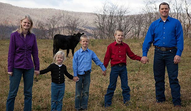 Family: Sheri and Daniel Salatin and their three children out on the family farm in Virginia.
