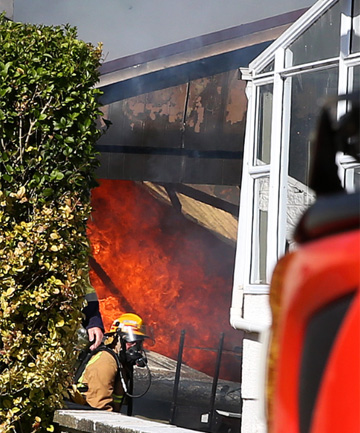 Firefighters battle a blaze in Edinburgh Cres, Invercargill.