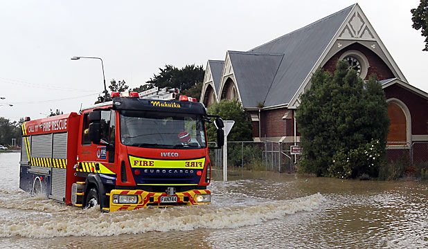 WATERLOGGED: A fire engine navigates floodwaters at the corner of Aynsley Tce and Opawa Rd.