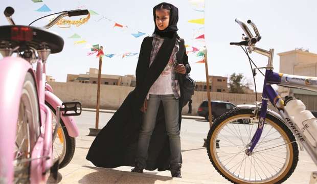 FANTASY: Wadjda (Waad Mohammad) dreams of owning her own means of transport.