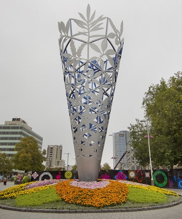 HOW WILL OUR GARDEN GROW?: The Chalice in Cathedral Sq, adorned with flowers.
