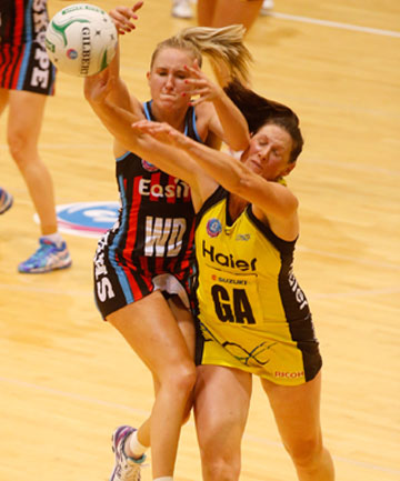 HIGHER AND HIGHER: Tactix Hayley Saunders outjumps Pulse's Donna Wilkins for a ball during the Canterbury side's stunning win in Napier.