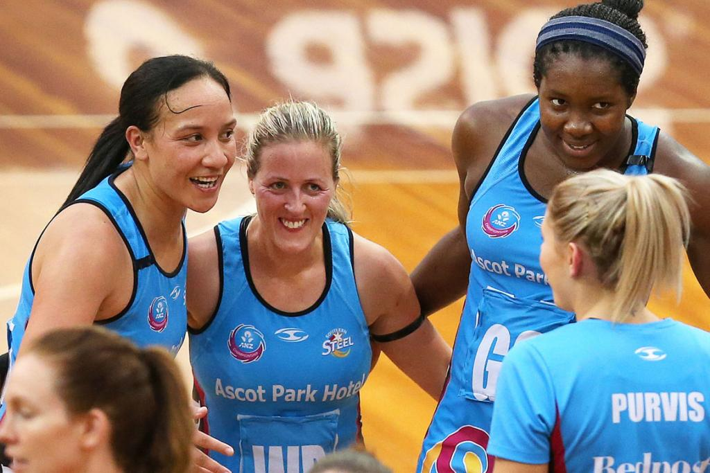Steel players, from left, Rachel Rasmussen, Wendy Frew and Jhaniele Fowler-Reid celebrate their 66-65 win over the Fever (Storm Purvis front right).