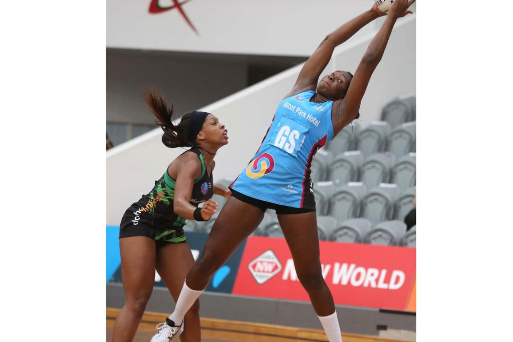 Steel's Jhaniele Fowler-Reid reaches for the ball with Fever's Eboni Beckford-Chambers on left.
