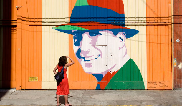 CITY OF COLOUR: Tango legend Carlos Gardel immortalised in graffiti in Abasto neighborhood.