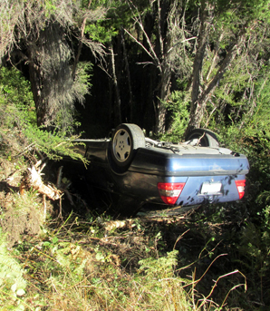 FLIPPED: A car was left upside-down in a ditch on the Hope Saddle after leaving the road and rolling on Monday afternoon.