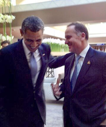 GOLFING TALES: John Key catches up with US President Barack Obama at the Nuclear Security Summit.
