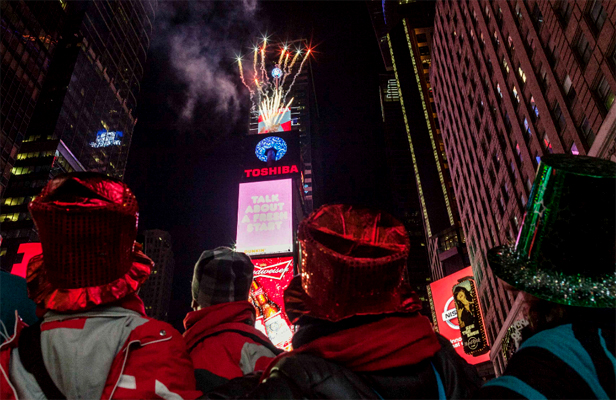 DROPPING THE BALL: People watch as the New Years' Eve ball drops in Times Square, New York.