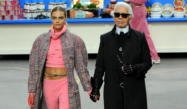 MAN OF STYLE: Karl Lagerfeld with uber-model Cara Delevingne at the recent Chanel Fall/Winter 14 show in Paris.