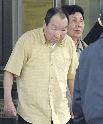 RETRIAL ORDERED: Iwao Hakamada, who had been convicted in the 1966 murder of a family and was sentenced to death in 1968, walks free from the Tokyo Detention Centre.