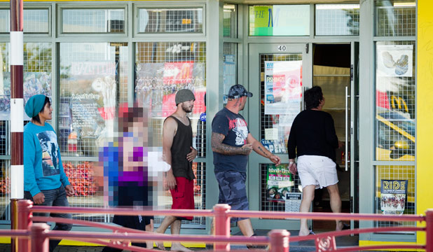 AFTERNOON HIGH: Customers gather at Te Awamutu's only legal high shop, M Centre, as it opens.