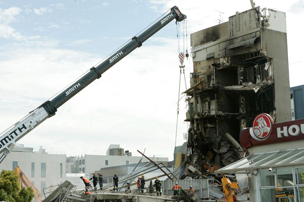 Rescuers search through the rubble of Christchurch's CTV building in February 2011.