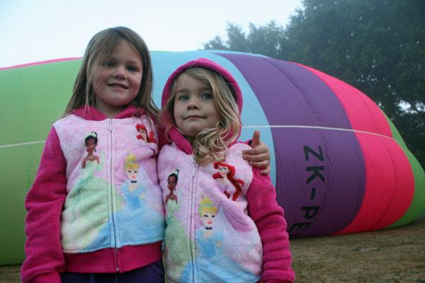 FAY THREE: Baylee-Rose, 6, and Amber Bankier enjoy time together while the hot air balloon is inflated.
