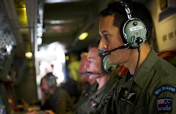 JOINING THE HUNT: Air Warfare Specialist Flight Sergeant Simon Martelli is one of the dedicated crew onboard the Royal New Zealand Air Force P-3K2 Orion scouring for signs of the missing flight MH370.