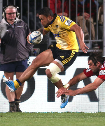 DYNAMIC: Alapati Leiua evades the tackle of Crusaders forward Sam Whitelock.