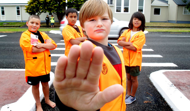 STOP IT: Waitara Central School pupils Aidan Martin, 10, front, with schoolmates Joshua Frost, 10, Astan Green and Ainsley Hanan, both 9, are tired of motorists breaking the road code.