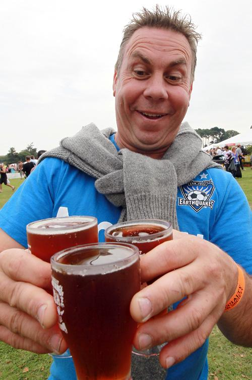 Ian Aldridge delivering beers to his mates at the Great Kiwi Beer Festival in North Hagley Park in Christchurch.