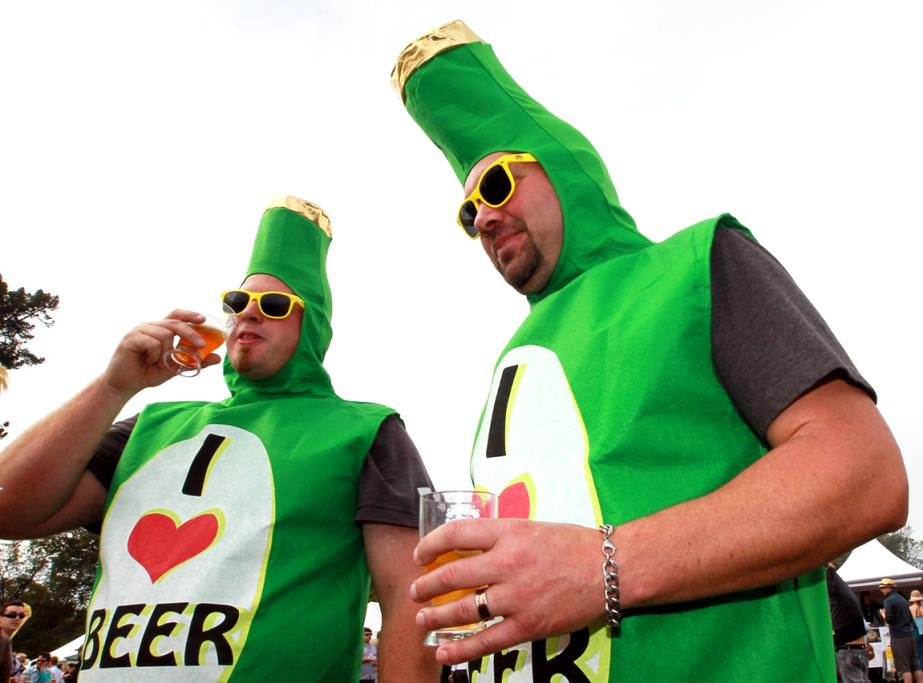 Dale Finlayson (L) and Shane Jarde share their love of beer at the Great Kiwi Beer Festival in North Hagley Park in Christchurch.