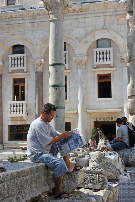 If you live inside Diocletian's palace, catching up on the news can be done in (Roman) style.