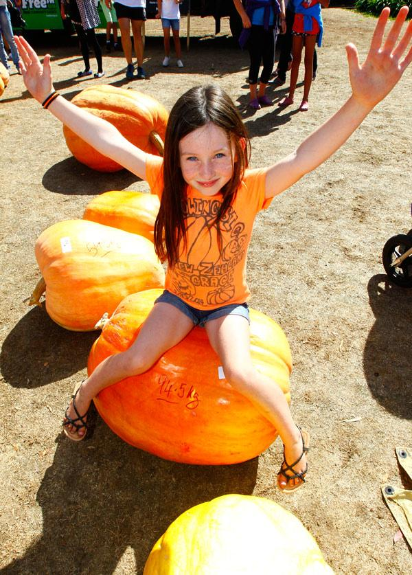 PUMPKIN FAN:  This mighty vegetable made a good seat for 7-year-old Grace Lusty.