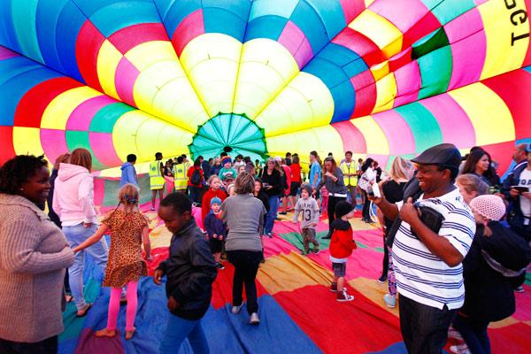 DAY FOUR:  People got the chance to investigate the interior of a real hot air balloon as they waited for the Nightglow to begin.
