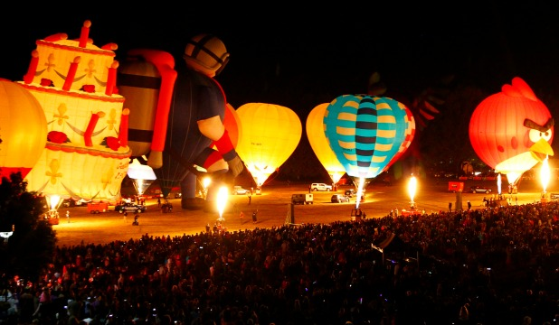 KER-BOOM: The balloon army appear to be skittled by an overhead explosion – but in reality they were being quickly deflated while the fireworks display drew everyone's attention to the heavens.
