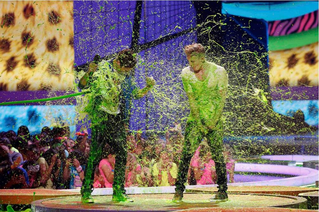 Austin Mahone (L) and Cody Simpson get slimed.