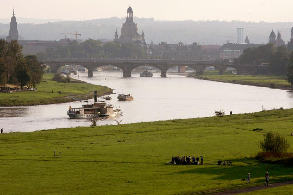 A general view shows a vintage steamboat sailing down the Elbe river, where the planned 'Waldschloesschenbruecke' bridge should cross the river, in front of the historic city centre of the eastern German city of Dresden.