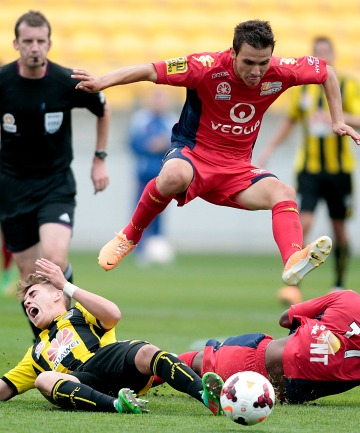Adelaide's Isaias flies over the top of the Phoenix's Tyler Boyd