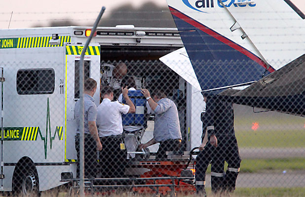 ARRIVAL: One of the two injured hitchhikers attacked near Franz Josef on Sunday arrives at Christchurch Airport last night after a flight from Greymouth. Both women were flown to Christchurch.