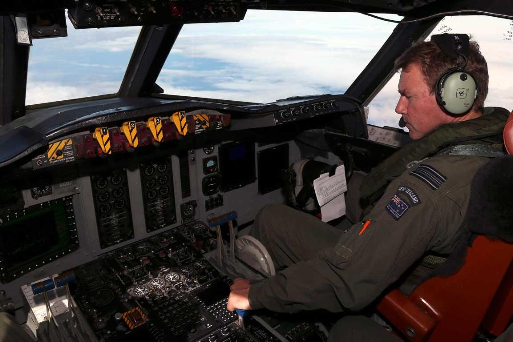 RNZAF co-pilot Squadron Leader Brett McKenzie sits in the cockpit of a P3 Orion during the search for MH370.