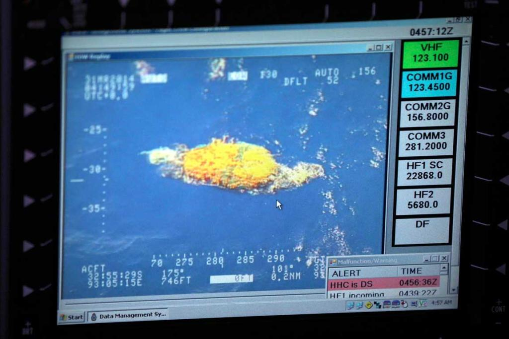 A picture taken of a computer monitor shows a piece of unknown debris floating just under the water.