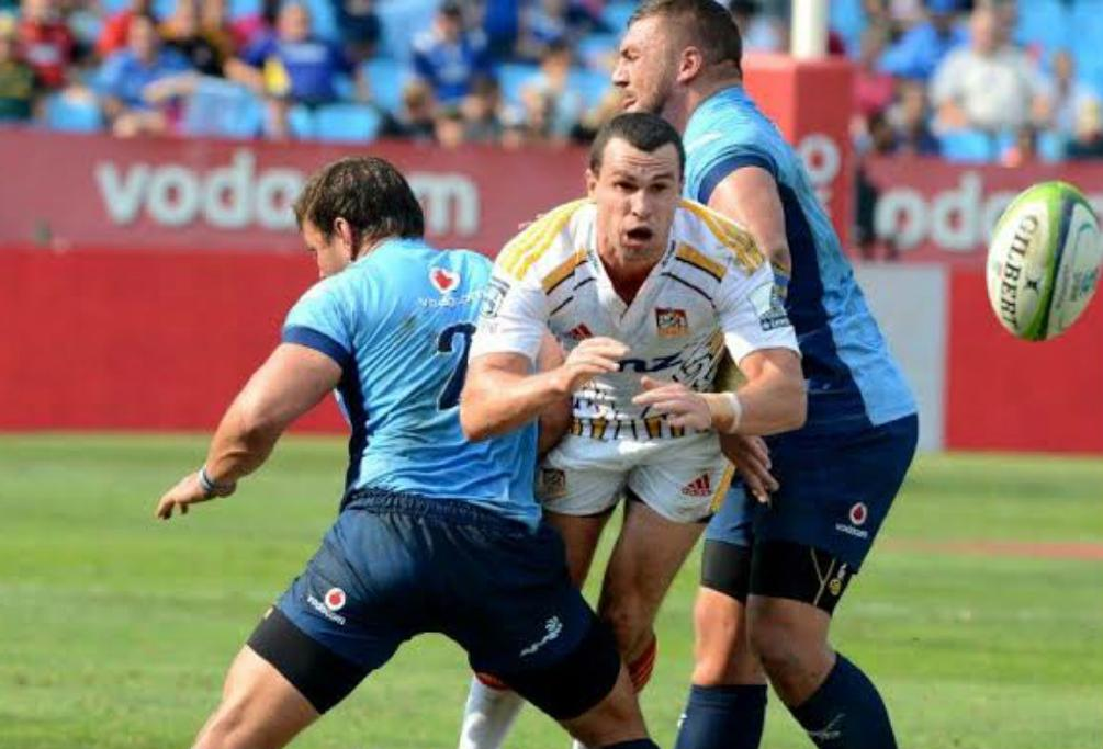 Caille Visagie and Dean Greyling of the Bulls tackle Tom Marshall of the Chiefs at Loftus Versfeld.