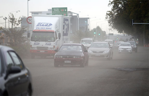 MOORHOUSE AVE: Traffic kicks up dust on Moorhouse Ave. Car dealers want