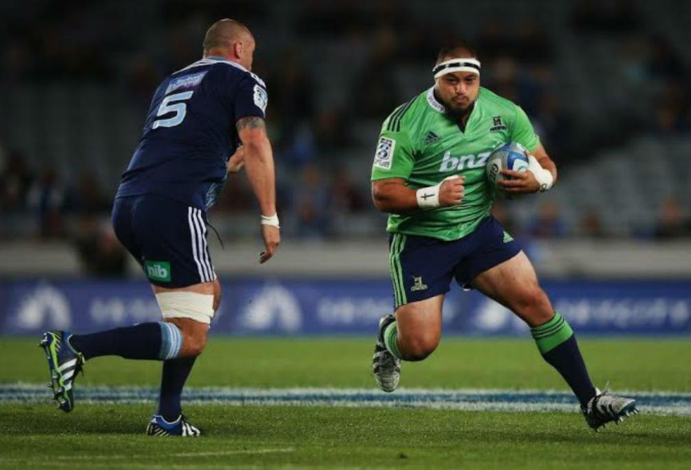 Kane Hames of the Highlanders makes a break against the Blues at Eden Park in Auckland.