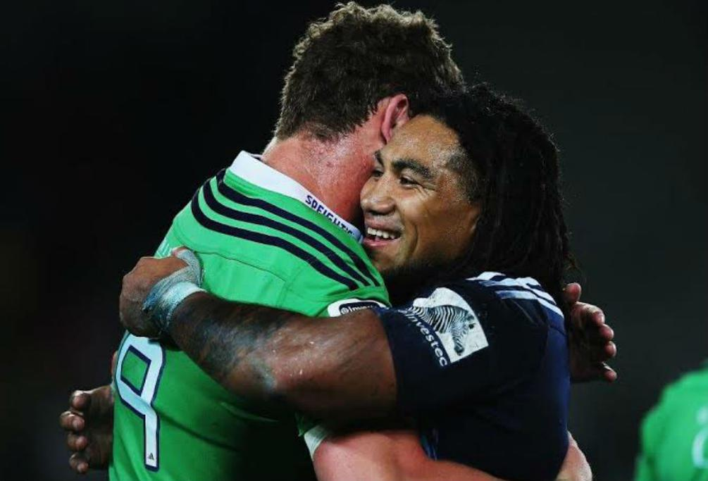Joe Wheeler of the Highlanders, left, and Ma'a Nonu of the Blues embrace after the full time whistle at Eden Park.